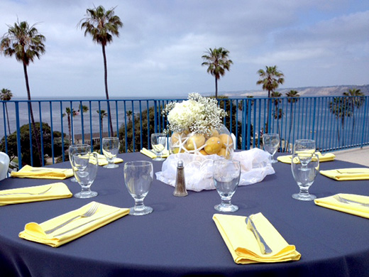 Table setting for a wedding reception at La Jolla Cove Suites.