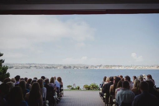 A wedding ceremony at The Garty Pavilion on Mission Bay full of guests.