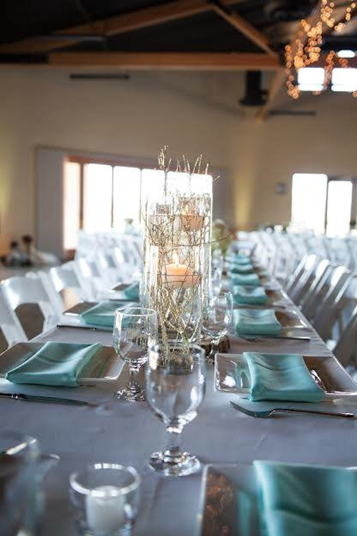 Glass and silverware on a wedding reception table by Events Inspired San Diego.