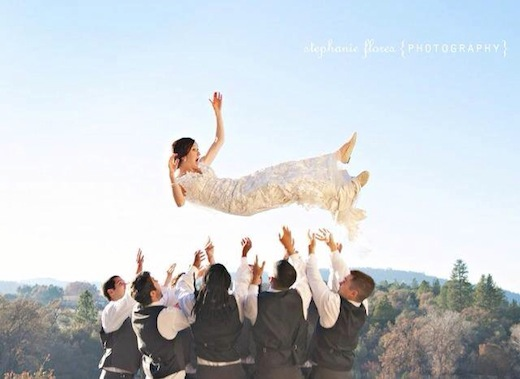 Events Inspired San Diego has bride being tossed by the wedding party.