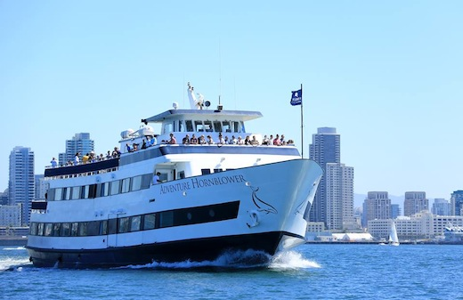 A Hornblower Cruises & Events boat cruising the water.
