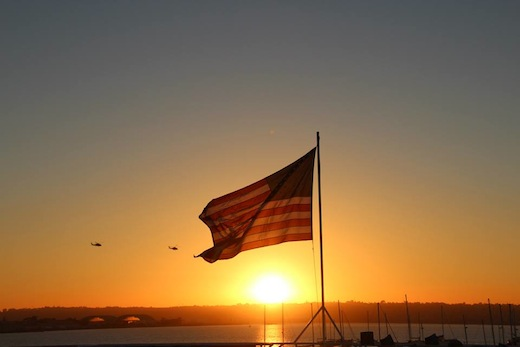 Flag and sunset on the Hornblower Cruises and Events boat.
