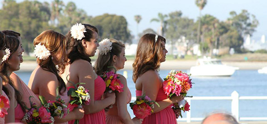 "Bridesmaids and maid of honor at a waterfront wedding ceremony. How will you ask your family member or relative ""Will you be my maid of honor?"""
