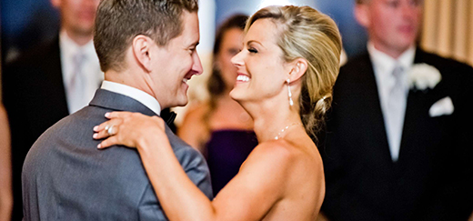 A couple dances the night away to their first dance song.