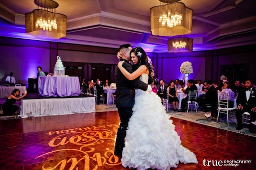 Newley wed couple with their first dance at their San Diego wedding reception.