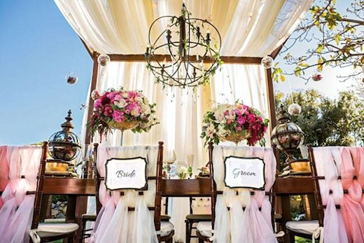 Couples chairs and table for reception at a San Diego wedding by Brilliant Event Design.