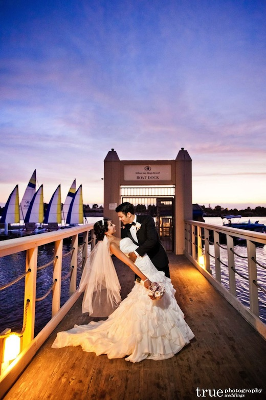 A couple on the boat docks at the Hilton San Diego Resort & Spa.