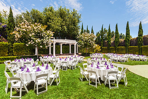 Outdoor wedding reception and ceremony setting at Handlery Hotel San Diego.