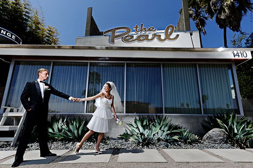 Newly married couple in front of The Pearl Hotel