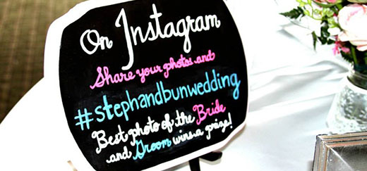Picture of a sign explaining a custom hashtag for a wedding