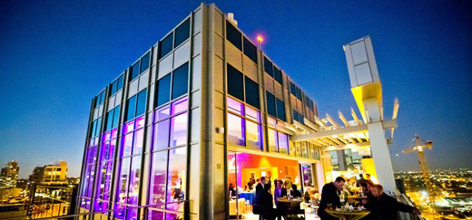 An outside view of a corporate event venue in the evening