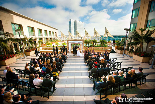 A wedding taking place on the outdoor terrace at Omni Hotel San Diego