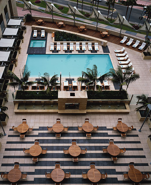 A birds eye view of the outdoor terrace and heated pool at the Omni Hotel San Diego