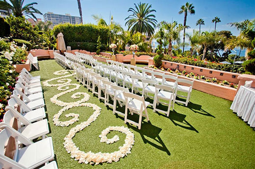 White seating over grass at La Valencia weddings