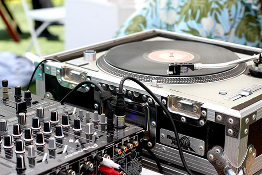Close Up of DJ Mixer and Turntable