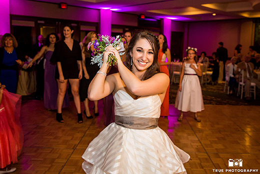 Bride Posing Before Bouquet Toss