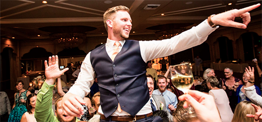 Groom Lifted Up On Dance Floor