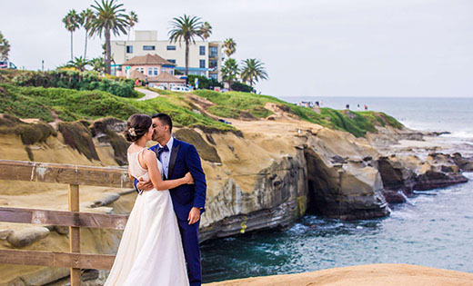 Groom and Bride Posing on Beach Cliff