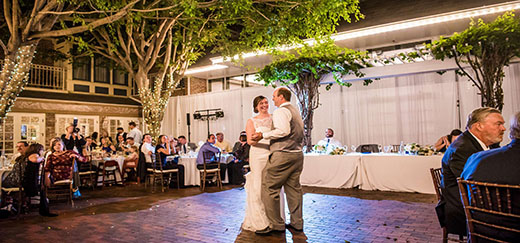 Bride and Groom Having First Dance with Background Lighting