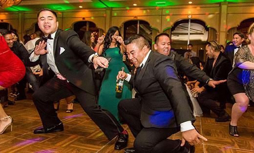 Groomsmen Dancing Low on the Dance Floor